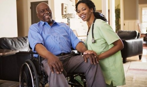 Man in wheelchair with nurse