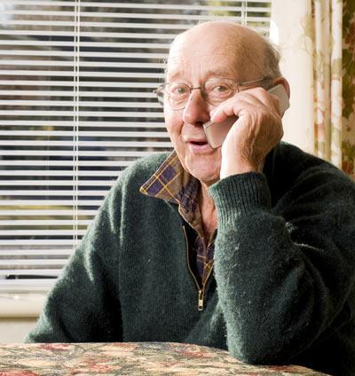 Elderly man talking on phone